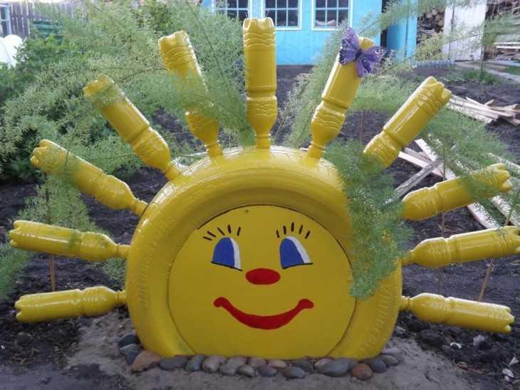Как сделать солнышко из покрышек 144